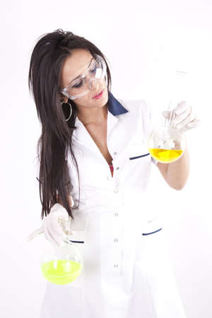 Young beautiful woman lab technician holding a test tube with yellow liquid. photo