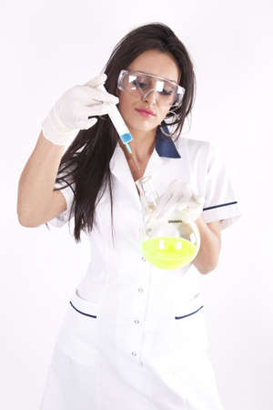 Young female laboratory technician with safety glasses working. photo