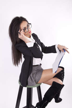 Young attractive sexy business woman with glasses sitting photo