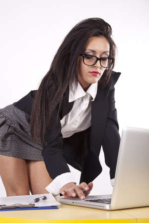 Young attractive sexy business woman with glasses working. photo