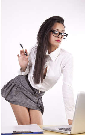 sexy business woman: Young attractive sexy business woman with glasses working.