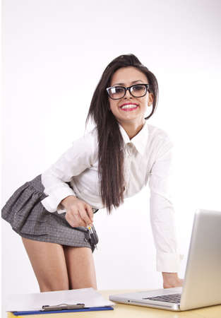 Young attractive sexy business woman with glasses smiling.