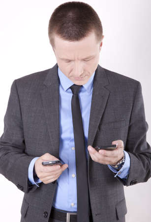 Young business man checking his smartphones. photo