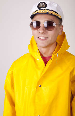 Attractive young boat captain with rain coat. photo