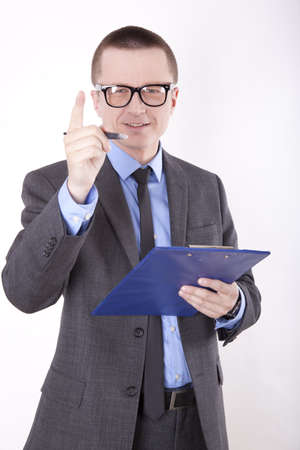 Portrait of a successfull young business man pointing up with finger. photo