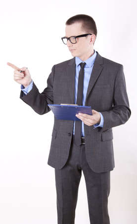 Portrait of a successfull young business man pointing right with finger. photo