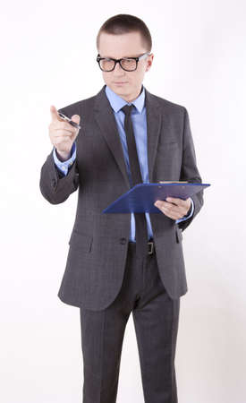 Portrait of a successfull young business man pointing forward with finger. photo