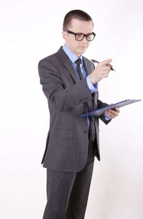 Portrait of a successfull young business man pointing left with finger. photo