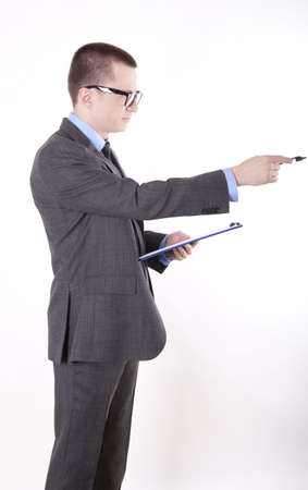 Portrait of a successfull young business man pointing right with a pen. photo