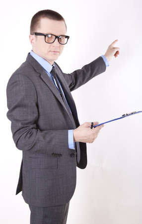 Portrait of a successfull young business man pointing with his left hand. photo