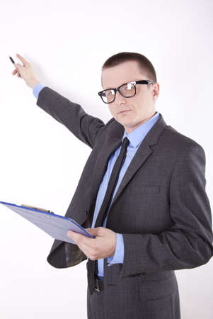 Portrait of a successfull young business man pointing with his right hand. photo