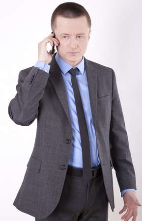 Portrait of a successfull young business man talking on a phone. photo