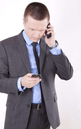 Portrait of a successfull young business man looking at a phone. photo