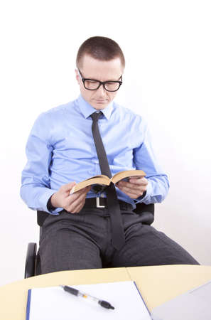 Portrait of a successfull young business man reading book. photo