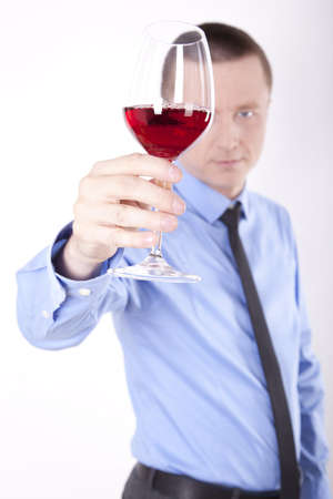 Portrait of a successfull young business man holding glass of wine. Stock Photo