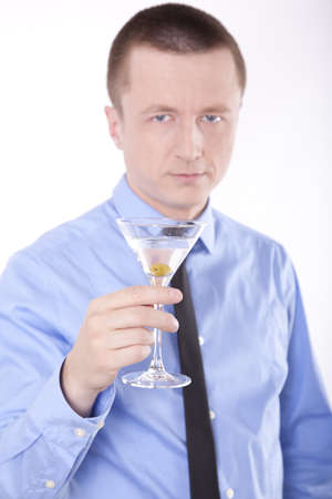 successfull: Portrait of a successfull young business man holding cocktail.