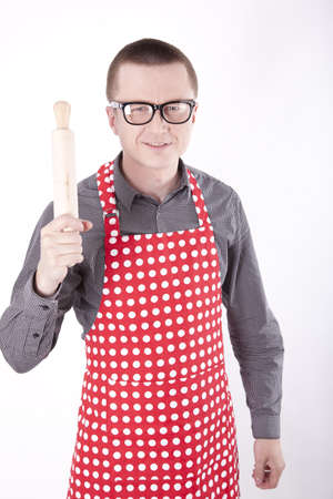 Portrait of a male cook in the apron with rolling pin. photo