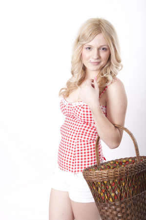 Portrait of a young attractive woman holding a basket and smiling. photo