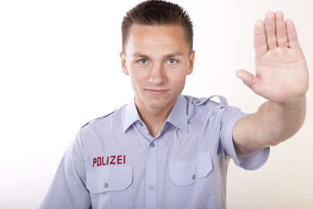 public servants: Portrait of a young attractive male policeman working. Stock Photo