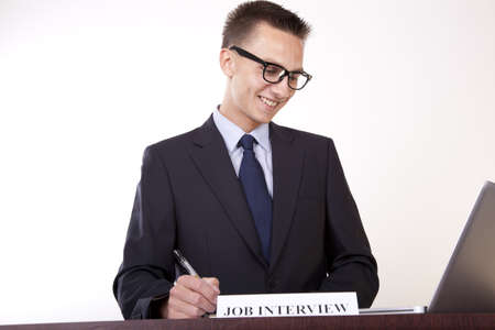 Portrait of a young attractive male secretary with a sign job interview. photo