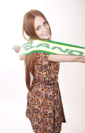 Portrait of a young beautiful female ireland fan. photo