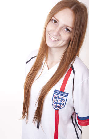 Portrait of a young beautiful female england fan. photo