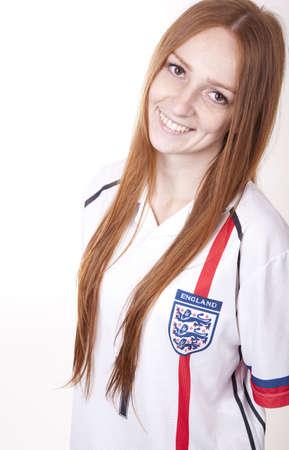 kibitz: Portrait of a young beautiful female england fan.