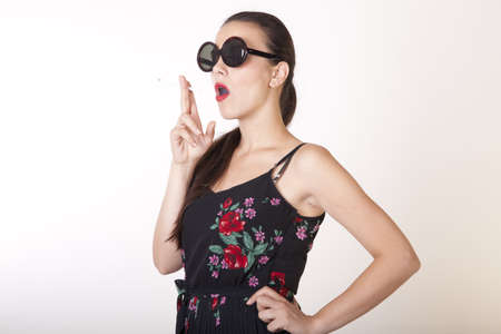 Portrait of a beautiful sexy woman smoking a cigarette.