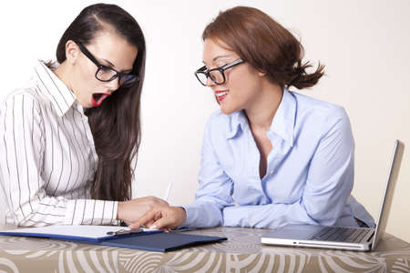 Portrait of a two young beautiful female secretaries working. Stock Photo - 16238309