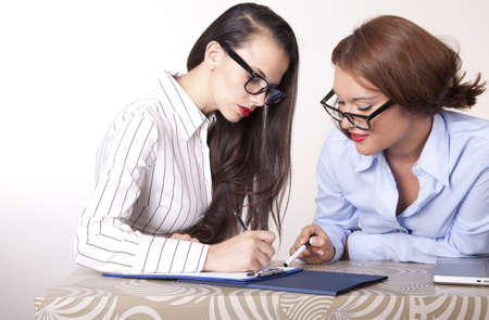 Portrait of a two young beautiful female secretaries working. Stock Photo - 16238300