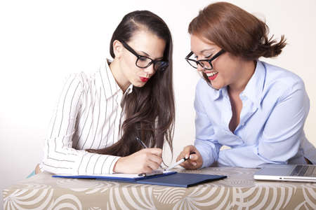 Portrait of a two young beautiful female secretaries working. Stock Photo - 16238299