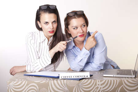 Portrait of a two young beautiful female receptionists showing direction. Stock Photo - 16238370