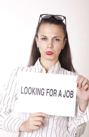 Portrait of a young beautiful woman holding a sign looking for a job. Stock Photo - 16238576
