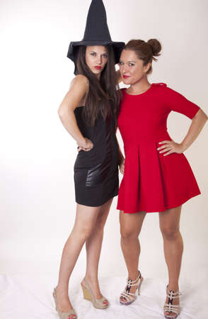 Portrait of a two beautiful women in fancy dresses. Stock Photo
