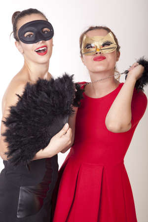 Portrait of a two beautiful masked women. photo