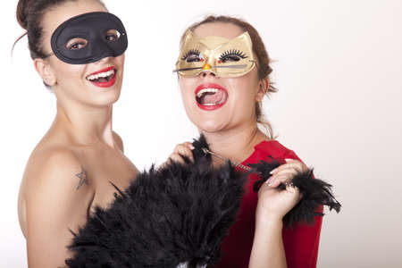 Portrait of a two beautiful masked women  Stock Photo - 16193897