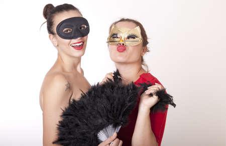 Portrait of a two beautiful masked women Stock Photo - 16193892