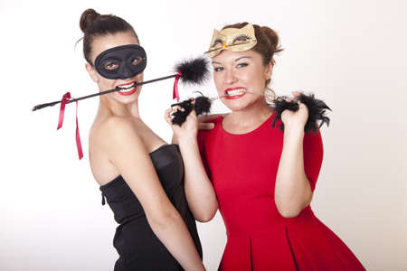 Portrait of a two beautiful masked women Stock Photo - 16193896