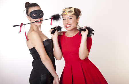 Portrait of a two beautiful masked women  photo