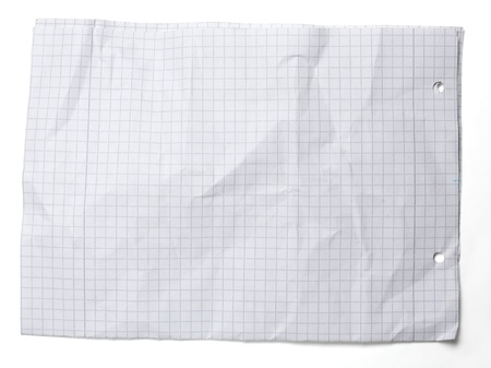 Crumpled squared sheet of paper isolated on white  photo