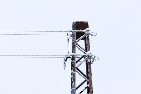 rusty old power-line isolated on with winter-sky  photo