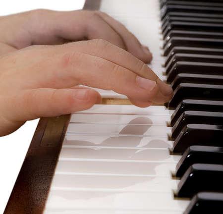 reflektion: transparent hand playing piano