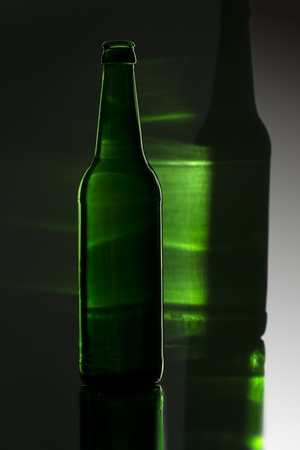green bottle with colored reflection  photo