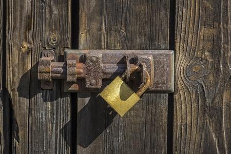 Old key lock on wooden door   photo