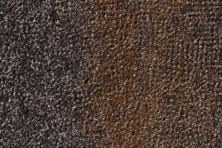 hammered: hammered granite background in black and red. Stock Photo
