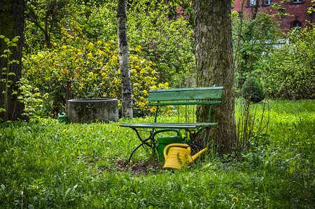 garden bench: garden bench with yellow ewer