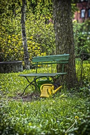 ewer: garden bench with yellow ewer