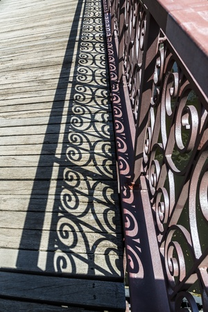 detail of an old bridge with decorated handrail. photo