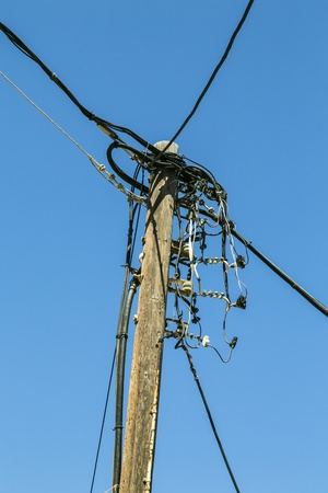 powerline: old wooden powerline, isolated on blue sky