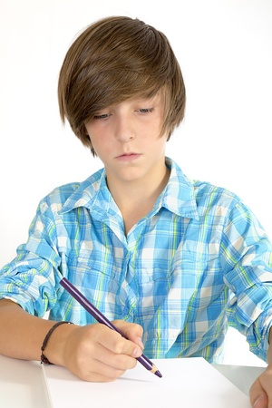 school boy working with a pencil, isolated on white